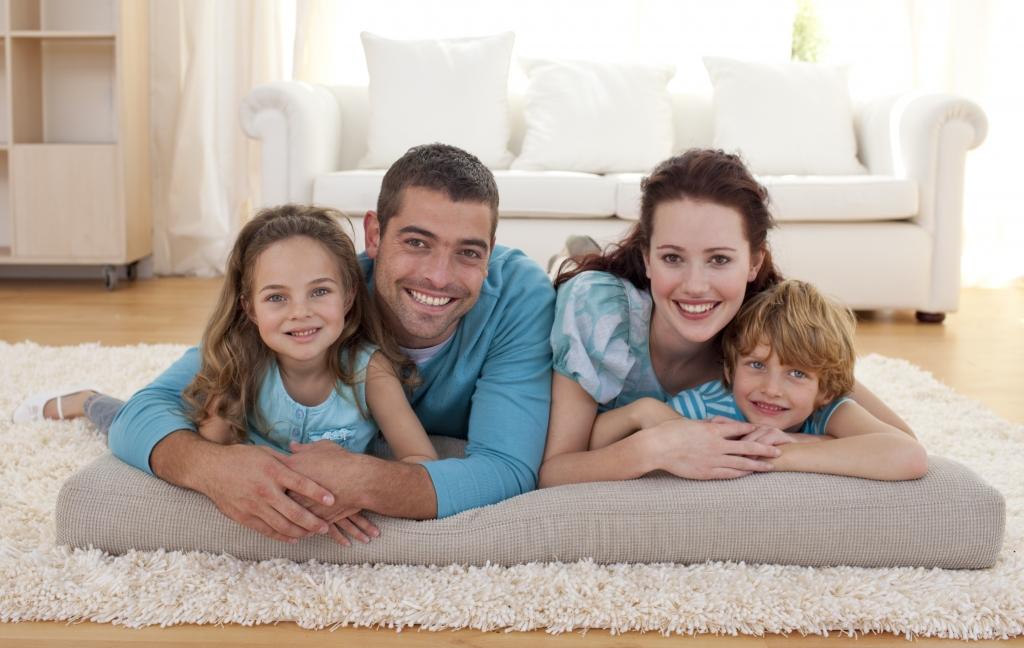 Family on floor lying in living-room